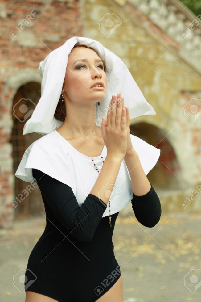 15037467-sexy-a-hot-caucasian-girl-wearing-a-nun-outfit-in-sunny-day-outdoor-praying-looking-to-the-sky